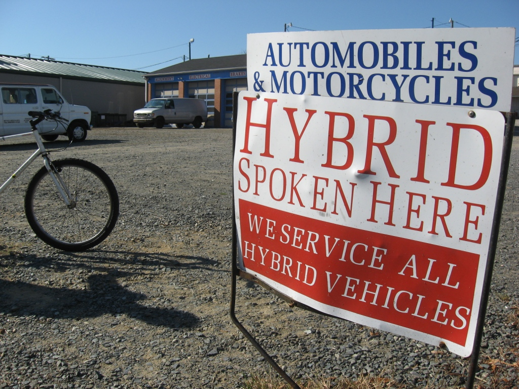 Sign saying 'hybrid' by bike